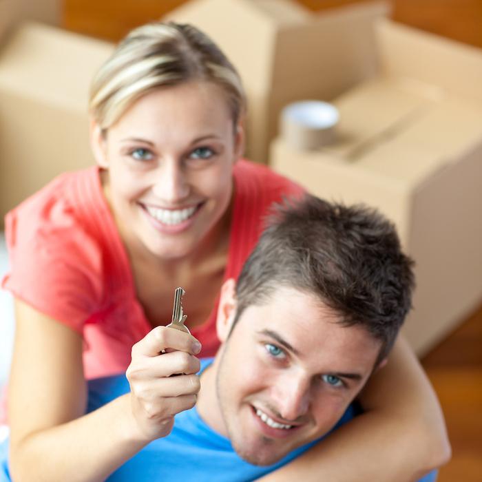 Couple holding a key